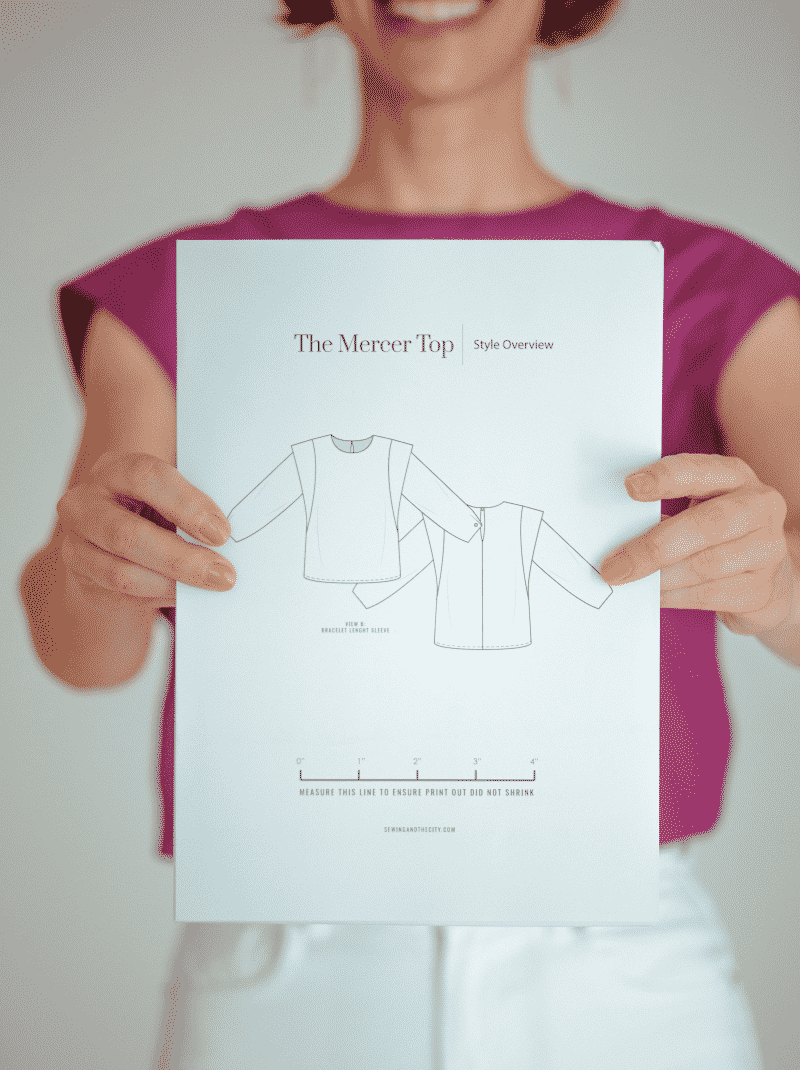 woman holding PDF sewing pattern in hands